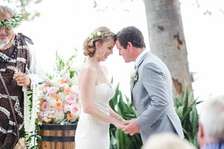 bride-and-groom-touch-foreheads-before-exchanging-vows-at-maui-hawaii-outdoor-wedding