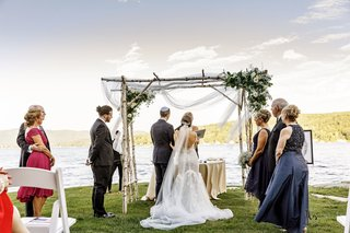 jewish-wedding-with-chuppah-made-of-birch-and-drapery-ceremony-on-shore-of-lake