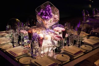 purple-flowers-and-glassware-on-mirror-reception-table