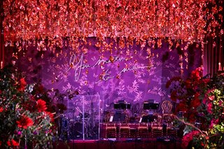 purple-neon-sign-you-matter-to-me-red-flowers-hanging-from-ceiling-over-dance-floor-live-band-stage