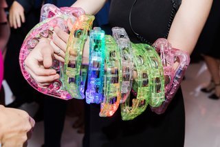 colorful-plastic-tambourines-on-dance-floor-during-wedding-reception