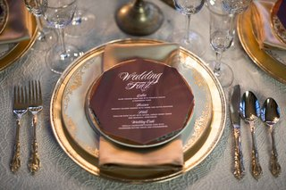 red-octagonal-dinner-menu-gold-details-wedding-styled-shoot-classic-vintage-calligraphy-setting
