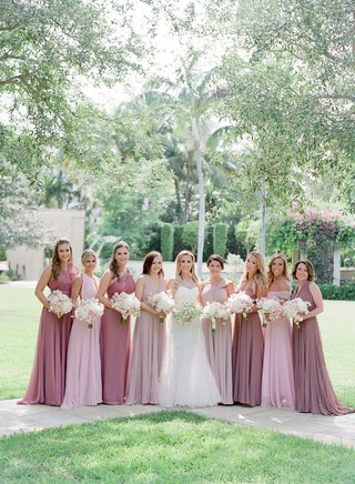 bride-in-romona-keveza-wedding-dress-and-bridesmaid-dresses-pink-and-mauve-dresses-white-bouquets