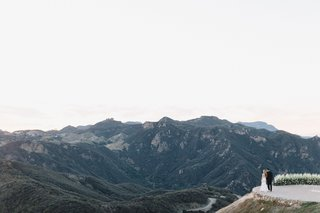 bride-and-groom-look-off-at-the-santa-monica-mountains-malibu-rocky-oaks