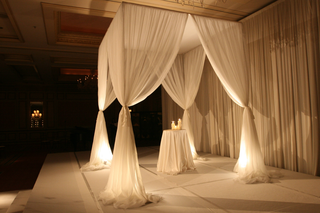 chuppah-constructed-of-sheer-white-fabric