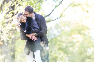 bride wearing black fur jacket maya myers engagement session