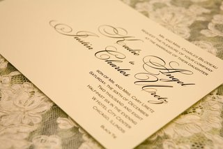 white-wedding-invite-with-blue-and-black-calligraphy