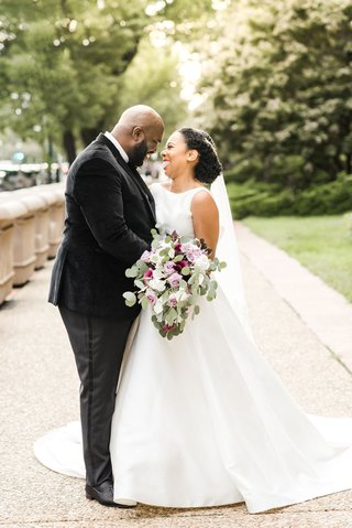 wedding portrait of bride and groom smiling and laughing together washington dc outdoor photo