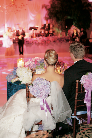 back-of-bride-and-groom-at-sweetheart-table