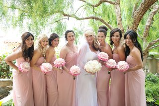 bride-in-white-ombre-dress-with-pink-bridesmaid-dresses
