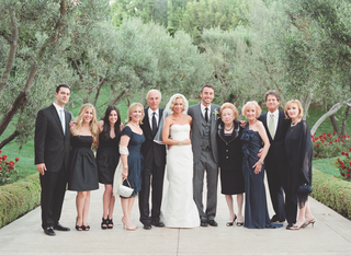 simone-harouche-in-a-strapless-carolina-herrera-gown-groom-in-a-grey-tom-ford-suit-with-loved-ones