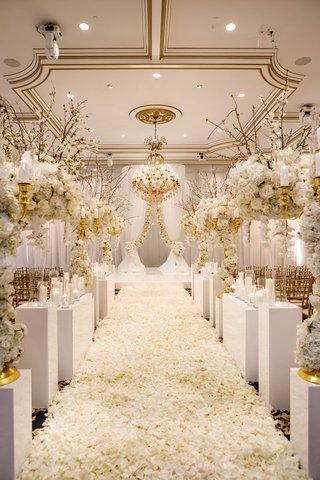 white-and-gold-ballroom-wedding-ceremony-white-flower-petals-arrangements-gold-molding-chandelier