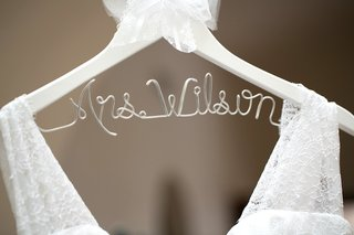 white-clothing-hanger-spelling-out-mrs-last-name