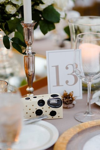 wedding-reception-table-disposable-camera-heart-design-on-reception-table-for-guests-table-number
