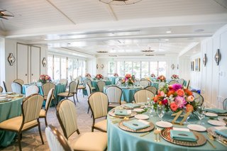 pastel-blue-linens-with-colorful-flowers-inside-restaurant