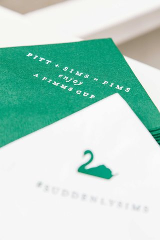 white-cocktail-napkin-with-green-swan-and-hashtag-and-green-signature-cocktail-napkin