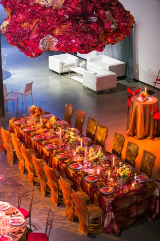 long-kings-table-with-orange-and-red-color-scheme-inspired-by-fire