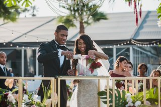 bride-and-groom-pouring-different-colored-sand-into-canister-wedding-unity-ceremony-ideas