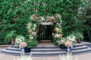 garden wedding ceremony greenery white pink flowers blue white vases jewish wedding at four seasons