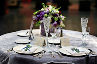 wedding-reception-sweetheart-table-with-a-centerpiece-of-purple-and-white-flowers