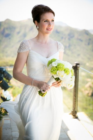 reem-acra-wedding-dress-with-beaded-cap-sleeves-and-twisted-bodice
