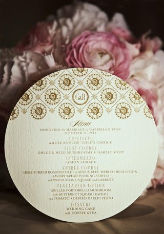 gold-motif-and-monogram-on-circular-menu