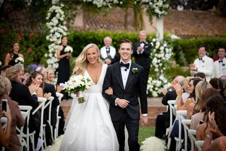 bride in anne barge v  neck wedding dress groom in tuxedo formal outdoor ceremony recessional
