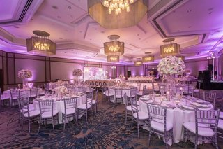 wedding reception silver chairs blush ivory centerpieces violet uplighting crystals classic decor