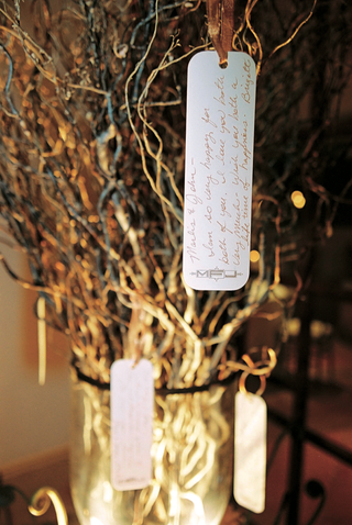 rectangular-cards-tied-with-golden-ribbon-on-branches