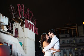 bride-in-a-strapless-vera-wang-gown-beaded-sash-dances-with-groom-in-long-white-sleeve-shirt