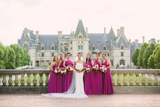 magenta-fuchsia-bridesmaid-dresses-in-front-of-biltmore-estate-in-asheville-north-carolina-wedding