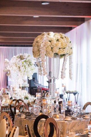 wedding-reception-centerpiece-tall-flower-arrangement-crystal-vase-orchid-ivory-hydrangea-flowers