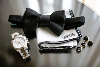 tom-ford-white-pocket-square-with-black-border-black-bow-tie-silver-watch-black-cufflinks