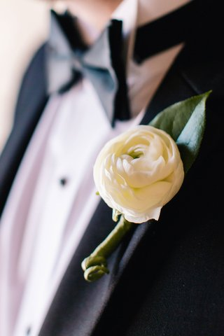 ranunculus-boutonniere-ivory-on-tuxedo-lapel-of-groom-in-bow-tie