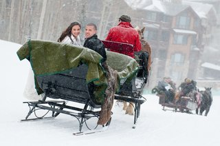 horse-drawn-sleigh-ride-with-bride-and-groom