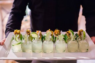 white-tray-with-margaritas-topped-with-limes-and-lime-taco-holders-appetizer-wedding