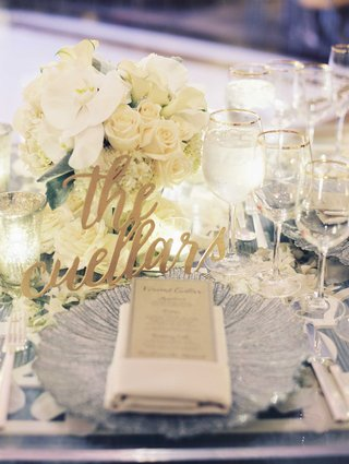 sweetheart-table-with-modern-calligraphy-laser-cut-sign-with-low-centerpiece-white-orchid-rose