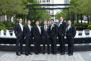 groom-and-groomsmen-in-hugo-boss-groomsmen-in-aquamarine-ties