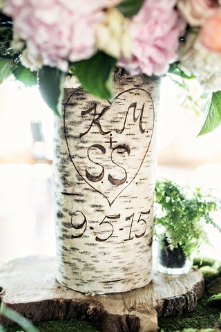 birch-tree-trunk-as-vase-with-initials-and-wedding-date-carved