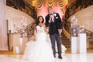 wedding-reception-bride-in-mermaid-wedding-dress-groom-in-velvet-tuxedo-jacket-toasts-float-candle