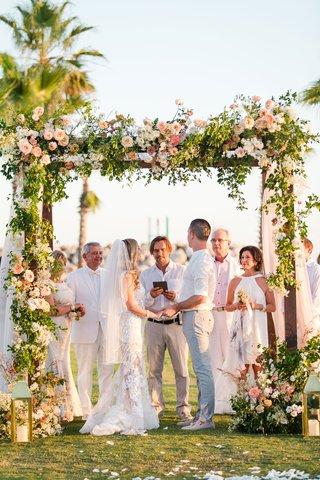 interfaith-secular-wedding-casual-destination-wedding-chuppah-with-florals