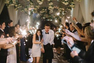 bride-in-second-wedding-dress-with-groom-running-through-tunnel-during-sparkler-exit-beverly-hills