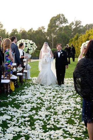 bride-walks-down-aisle-with-veil-over-face