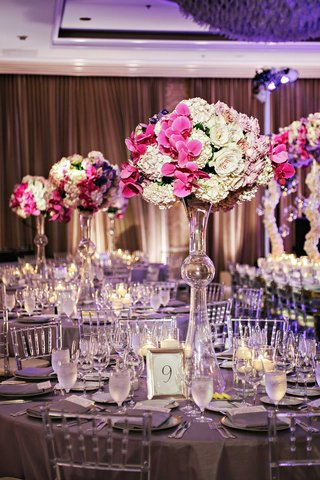 tall-latour-trumpet-vase-with-white-hydrangea-lavender-rose-and-fuchsia-orchid-centerpiece