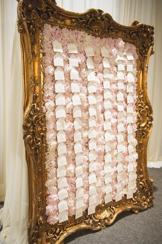 wedding-reception-escort-card-display-of-pink-white-peonies-in-gilt-frame