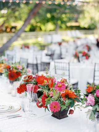 small-wedding-centerpieces-with-pink-and-orange-flowers-with-greenery