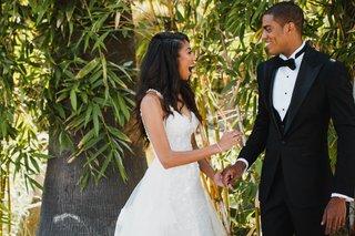 groom-in-custom-tuxedo-and-textured-jacket-bride-in-eve-of-milady-dress