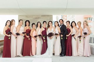 bride-in-ines-di-santo-wedding-dress-bridesmaids-in-blush-burgundy-oxblood-dresses-bridesman