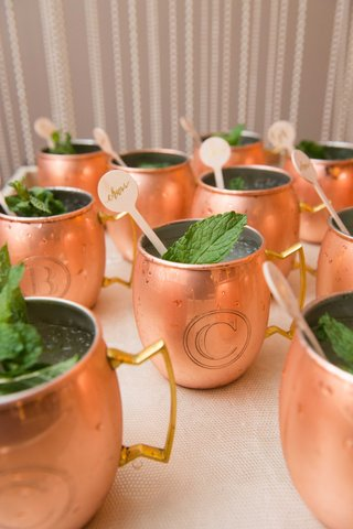 laura-hooper-calligraphy-cheers-calligraphy-drink-stirrers-in-moscow-mule-copper-mug-with-initials