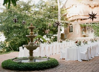 wedding-rehearsal-dinner-welcome-party-destination-in-mexico-tables-by-fountain-and-star-lanterns